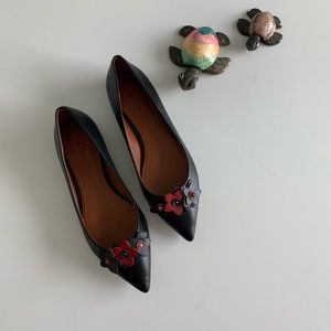 Coach flats with floral design